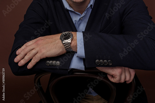 Fototapety, obrazy: Close up male hands leaning on chair back. He wearing modern watch. Business concept