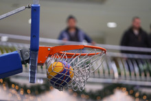 Basketball Hoop And Ball On The Background Of A Shopping Centre