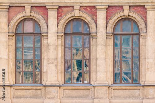 Three Windows In A Row On The Facade Of Urban Historic