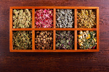 Dried Herbs And Flowers In Woo...