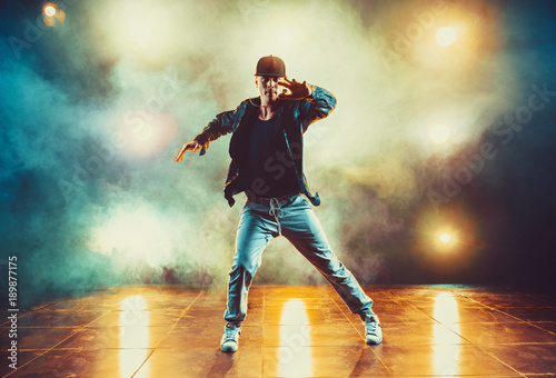 Fotografie, Tablou  Young man dancing