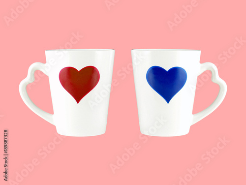 Poster Retro sign red and blue heart shape on white coffee cup with heart shaped handle isolated on pink background, two romantic cups for sweethearts
