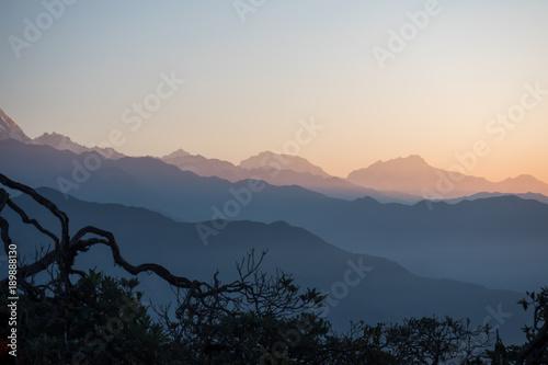 Foto auf Gartenposter Gebirge Wonderful wave-like shades of colors in a mountain landscape. Sunrise in the Himalayas, Nepal.