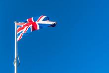 Union Jack Against A Blue Sky