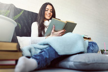 Beautiful Woman Reading Book At Home In The Morning