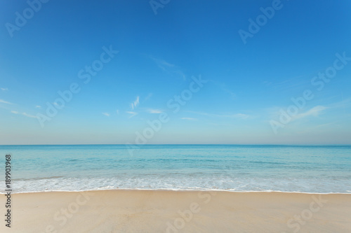 Tropical andaman seascape scenic off mai khao beach and wave crashing on sandy shore in phuket thailand,can be used for air transport to travel and open season to travel background.