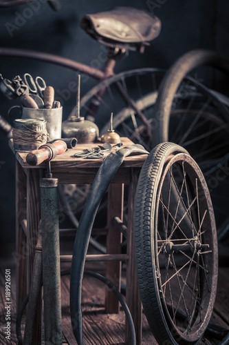 Fotobehang Fiets Vintage bicycle repair workshop with wheels, tools, and rubber patch
