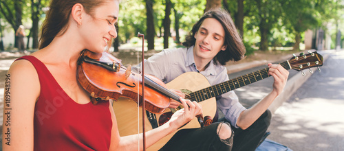 street musician romantic date. duet performance. couple love playing instruments together. art creation inspiration concept - 189948396