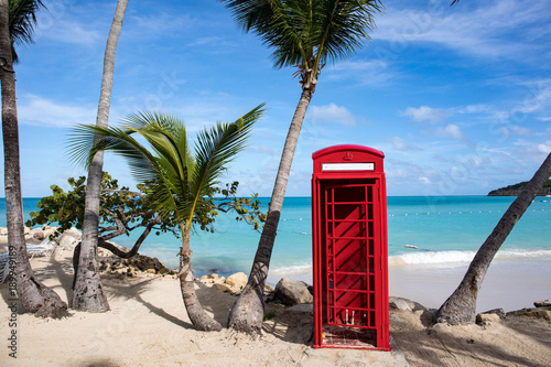 Phone booth in Dickenson Bay on Antigua in the Caribbean Wallpaper Mural