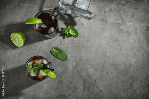 Two glasses with Cuba Libre cocktail on table Wallpaper Mural