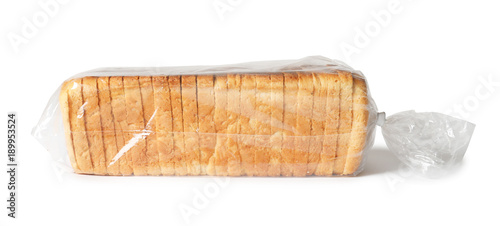 Package with slices of bread for toasting on white background