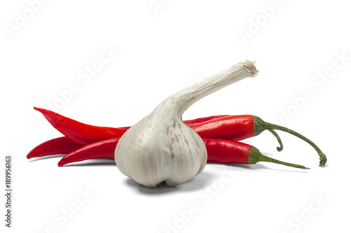 Staande foto Hot chili peppers Red hot chili pepper and garlic isolated on white background.