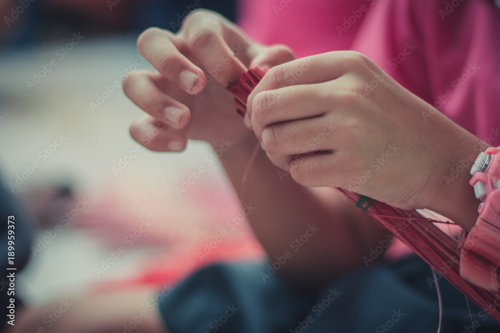 Fototapety, obrazy: Closeup to hand of Thai students grade 4 in primary school are weaving pattern thai.