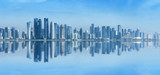 Futuristic urban skyline of Doha, Qatar. Doha is the capital and largest city of the Arab state of Qatar. Panoramic landscape of West bay