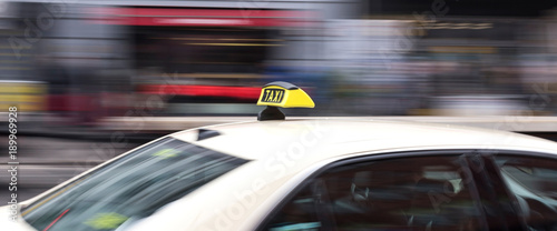 Fotografering german taxi cab speeding in the city