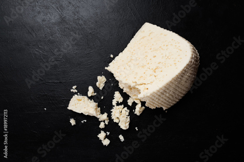 greece feta cheese on dark background. farming industry. milk products. gourmet food.