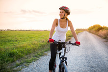 Smiling Girl On A Bicycle Outs...