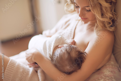 Photo  Mother Feeding a baby