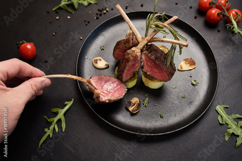 tasting delicious gourmet rack of lamb recipe concept. meat restaurant meal. luxury lifestyle.