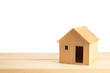 Toy wooden house model on white