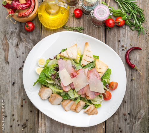 Staande foto Zuivelproducten Healthy Grilled Chicken Caesar Salad with Cheese and Croutons