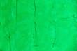 Leinwanddruck Bild - bright green stone wall
