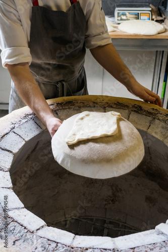 Fotografie, Obraz  Chef making khachapuri in tandoor
