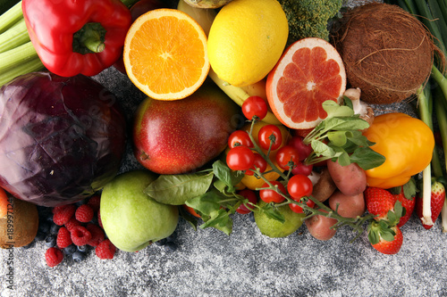 Composition with variety of raw organic vegetables and fruits. Balanced diet © beats_