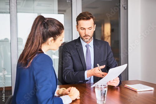 Fototapeta Recruiter conducting business job interview with female applicant in office obraz