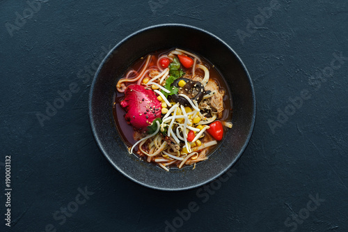 Poster Ready meals Ramen dish on dark background. Traditional Asian fast food meal. Delicious noodle soup