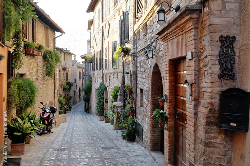 Traditional italian medieval alley in the historic center of beautiful little town of Spello, Perugia , in Umbria region - central Italy © tanialerro