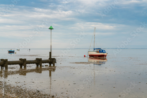 Fotografie, Obraz  Boats at low tide on the shore of the River Thames, seen in Southend-on-Sea, Ess