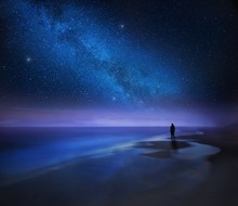 Starry Night Sky Over Sea And ...