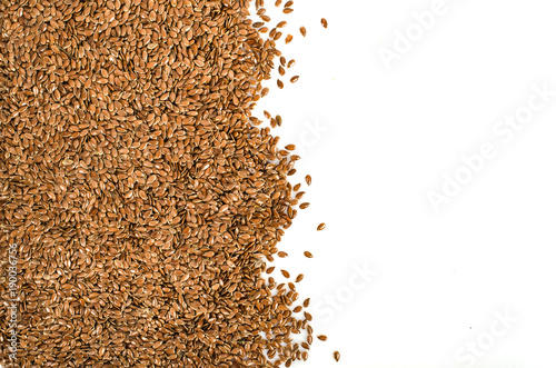 Fotografía  Crushed, milled flax, linen seeds isolated on white background, top view