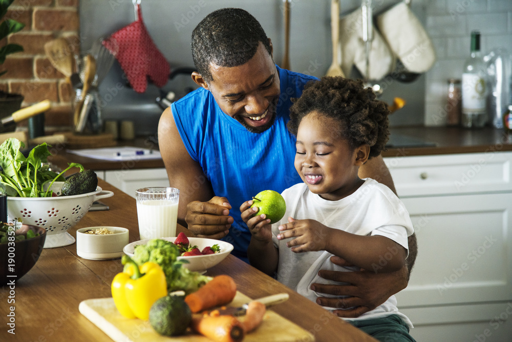 Fototapety, obrazy: Dad and son cooking together