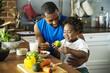 Leinwandbild Motiv Dad and son cooking together