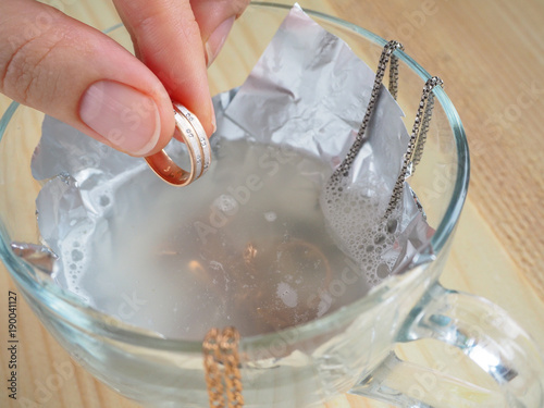 Cleaning gold and silver jewelry. Cleaning women jewelry concept.