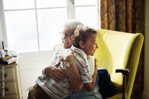 Fényképezés Grandma and grandson hugging together