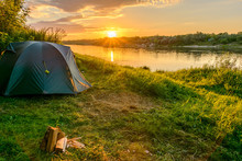 Camping Tent In A Camping On The River Bank