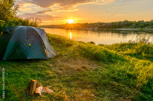 Obraz Camping tent in a camping on the river bank - fototapety do salonu