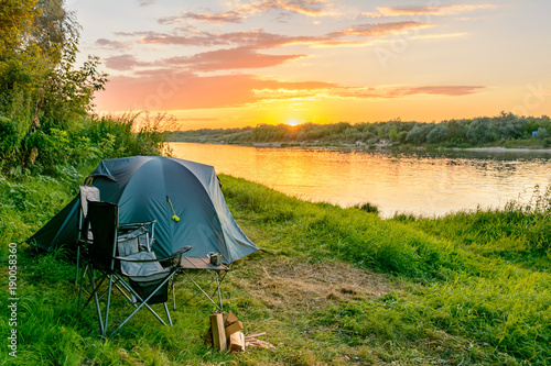 Spoed Foto op Canvas Kamperen Camping tent in a camping in a forest by the river