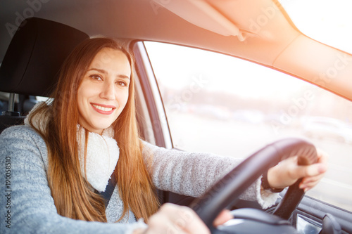 Young woman drive a car in winter