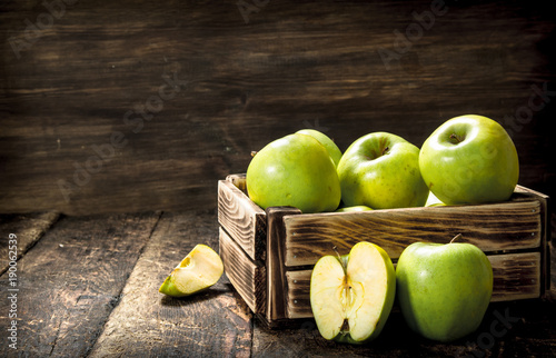 Box with green apples.