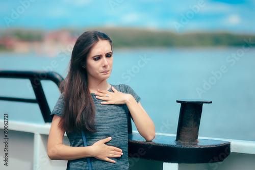 Fotografie, Obraz  Sea sick woman suffering motion sickness while on boat