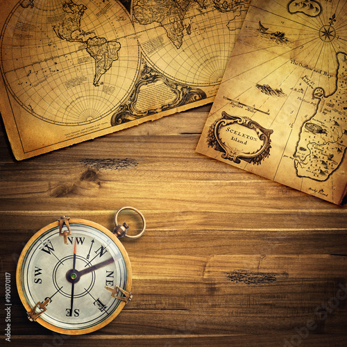 Foto op Plexiglas Noord Europa Old vintage retro compass on ancient map background. Travel geography navigation concept background.