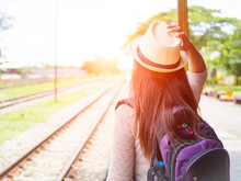 Traveler Woman Walking And Waits Train On The Railway Platform. Vacation And Travel Concept.