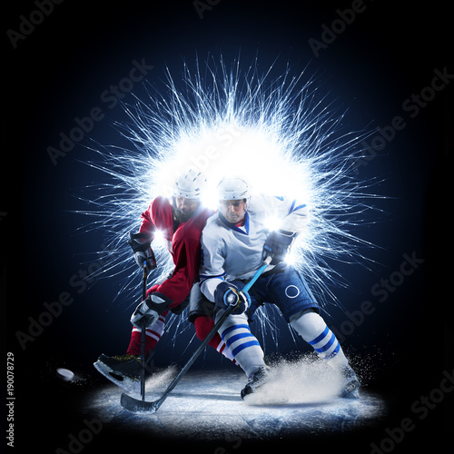 Ice Hockey players are skating on a abstract background Canvas Print