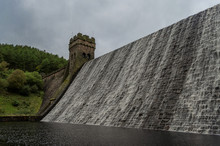 Water Flowing Over The Top The The Derwent Dam In The Peak District Of England