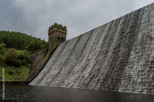 Fotografie, Obraz  Water flowing over the top the the Derwent dam in the Peak District of England
