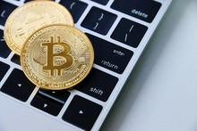 Gold Bitcoin On Keyboard Lapto...